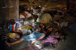 homeless family sleeping on floor